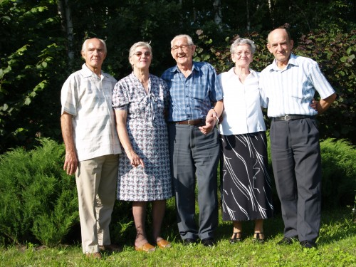 Dad (centre) reunited with his brothers and sisters after 64 years