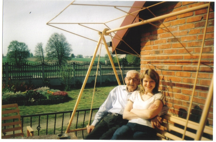 Dad with cousin Irena, on the swingseat (hustawka) on her patio