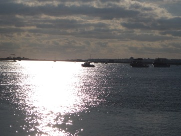 The sun setting on a silent sea