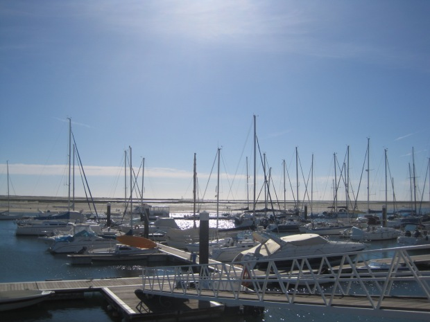 Can you make out the lighthouse at Farol on the island of Culatra between those masts?