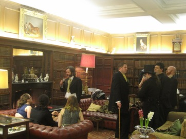 Guests assemble in the library