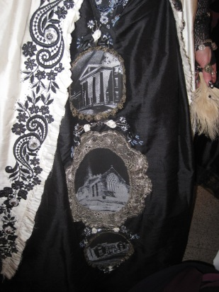 The motifs on the skirt,symbolising where they met, got engaged, and married