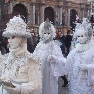 These masked revellers were beautiful in white too