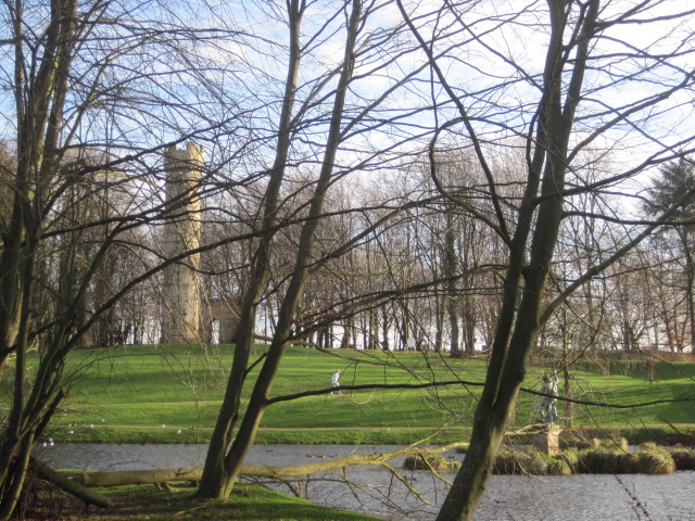 As you walk around the lake you catch glimpses of the tower and the statue