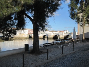 "A bench facing ""that"" bridge, in Tavira"