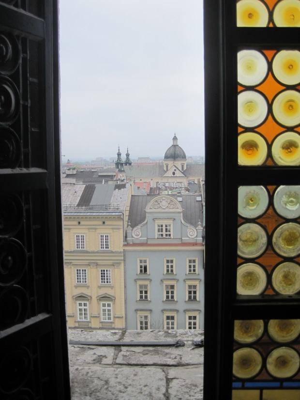 Through the windows of the bell tower of the Ratusz or Town Hall in Krakow