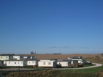 What a situation for a caravan park! Whitby Abbey in the background.