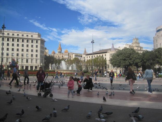 Placa de Catalunya, the transport hub, is always busy- pigeon feeding is strangely popular!