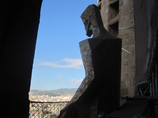 This figure looks down on the city- with compassion?