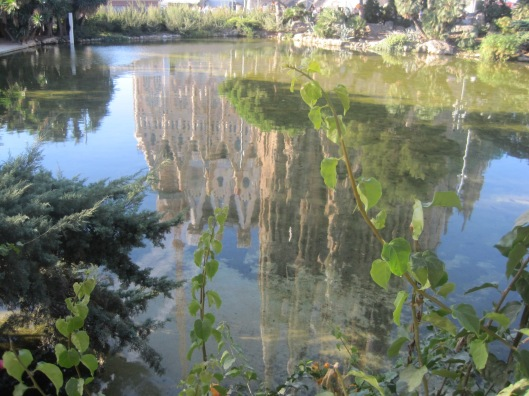 Sagrada Familia, reflected in the lake in Gaudi Square
