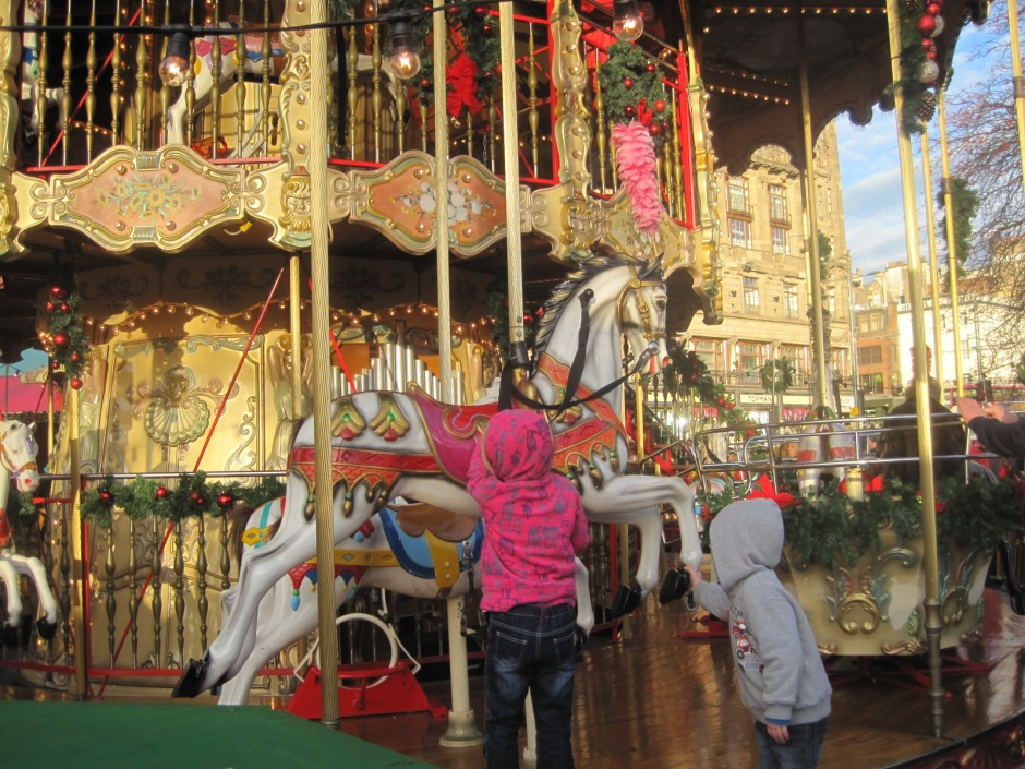 The children looked up hopefully at the carousel horse.