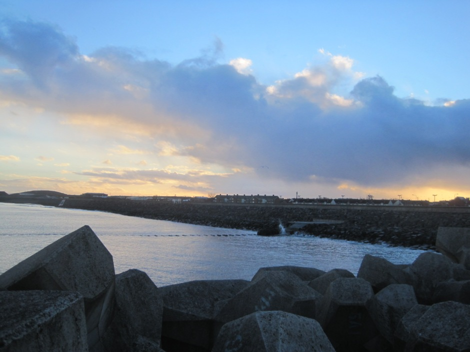 Sea defences softened by   sunset