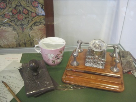 A delicate cup and inkwell