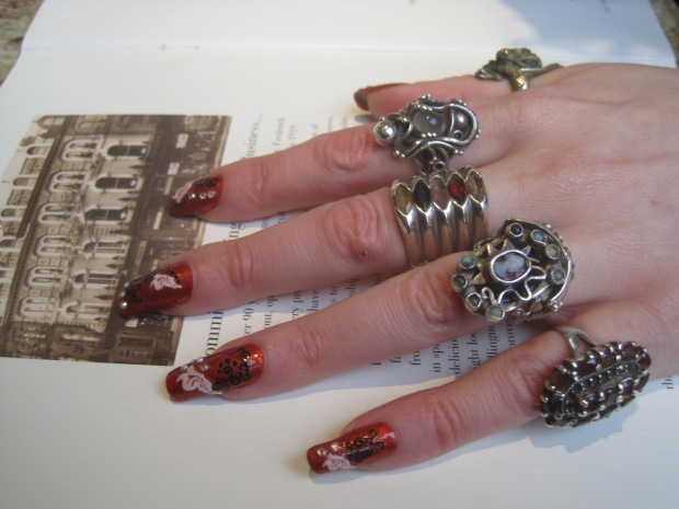 A close up of the wedding and engagement rings, made by her friend Kay