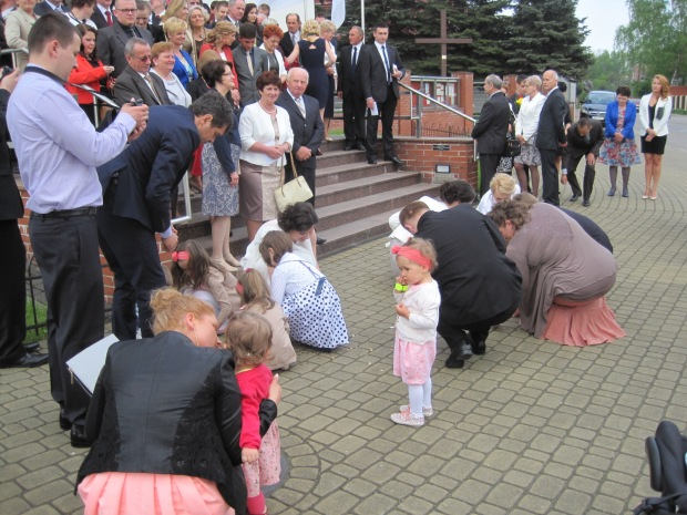 The children helping to pick up the 'lucky' coins