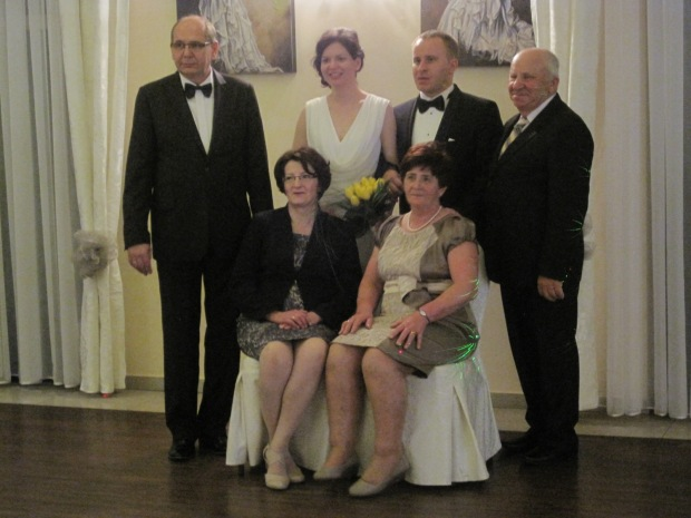 The bride and groom with parents