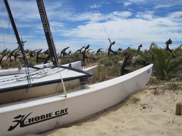 I liked the crisp catamaran beside the aged anchors