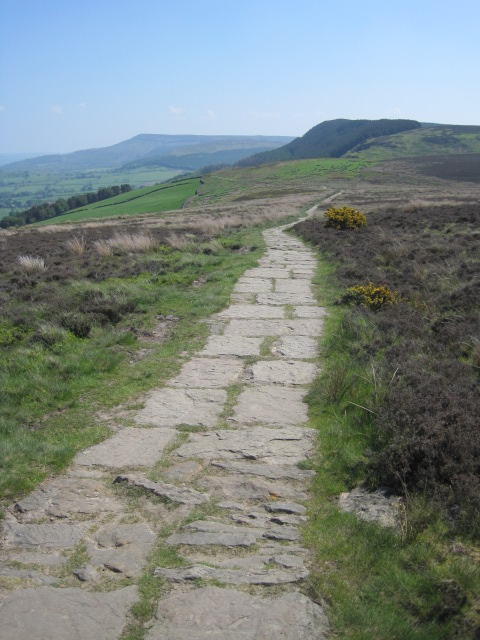 The waymarked trail leads off across the moors