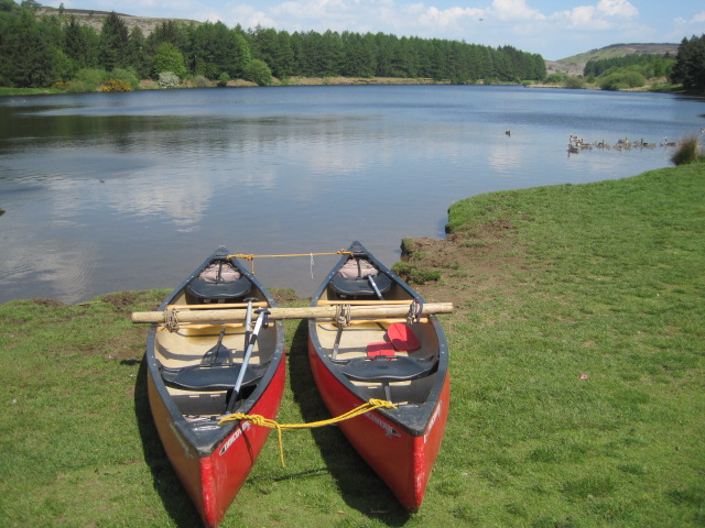 Two shiny red canoes! A rarity at the reservoir