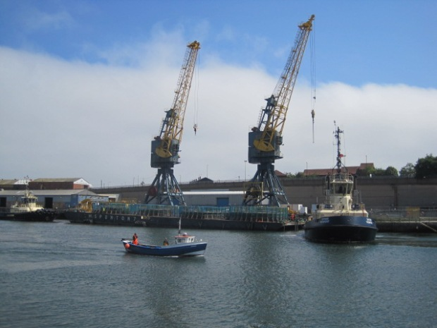 A couple of tugboats are just completing their business
