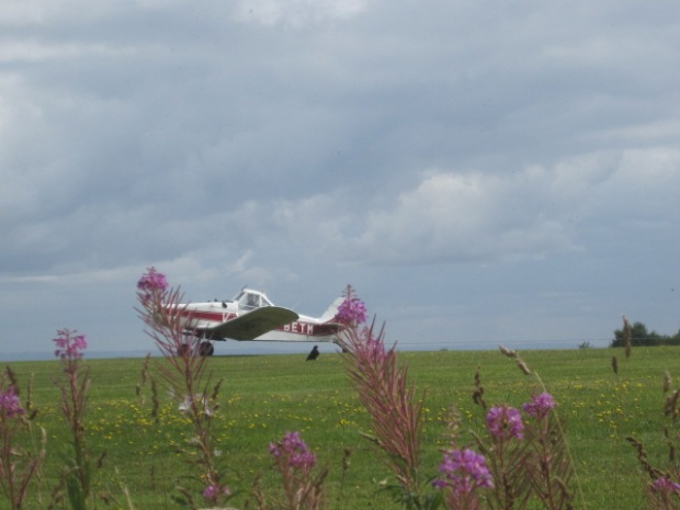 The plane whizzes past, towing the glider