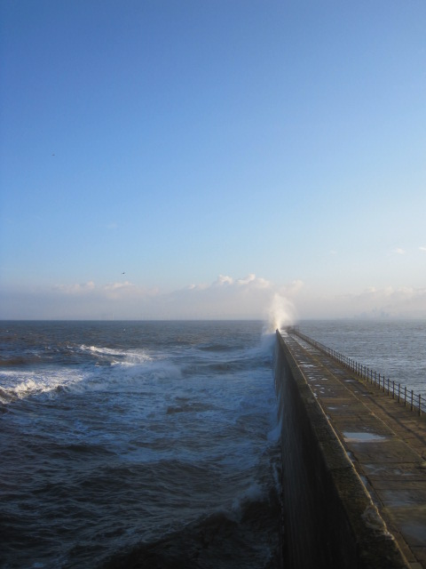 Whoosh goes the sea, against the pier!