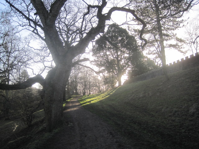 The path drops away from the castle walls
