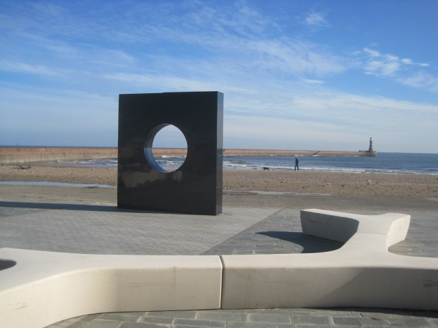 The marble monolith and the pier
