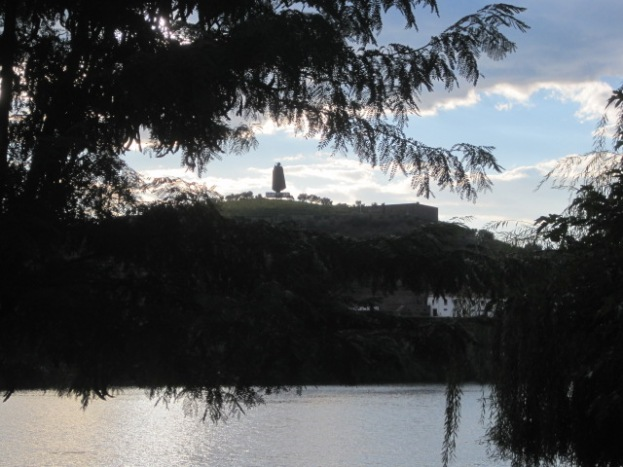The Sandeman's Port figure broods on a hillside
