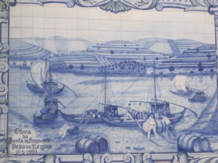 Azulejo panels illustrate the barcos rabelas