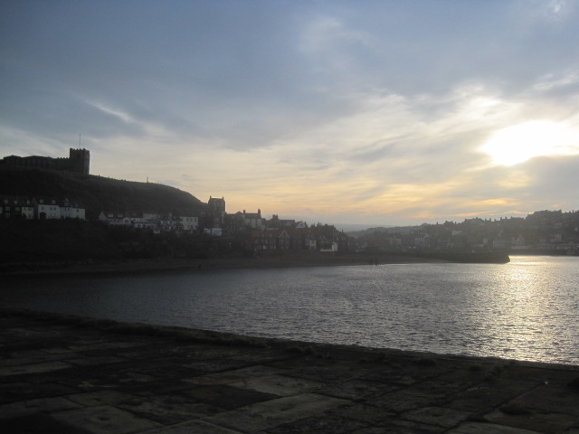 In short supply, the winter sun sets over Whitby harbour
