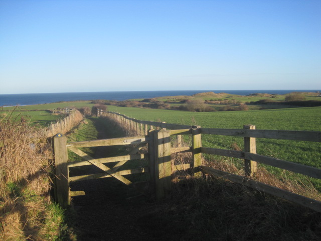 The path leads down towards the sea
