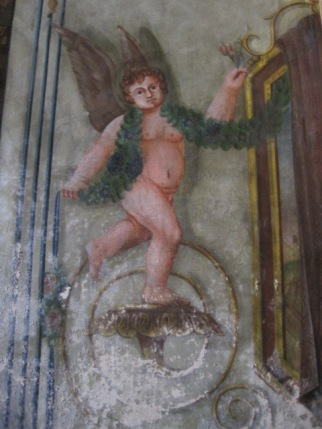 Cherubs adorn the wall panels