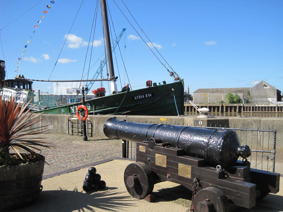 A canon from the Napoleonic Wars alongside an elderly fishing smack