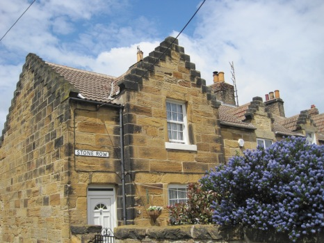 Moving into the village, we head along Stone Row