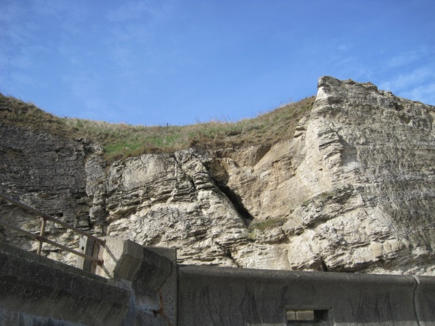 Overhead, the cliffs menace!