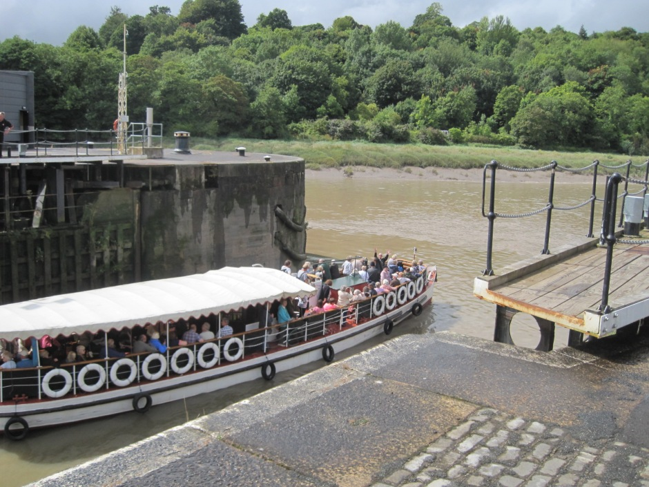 A tour boat passes through the lock