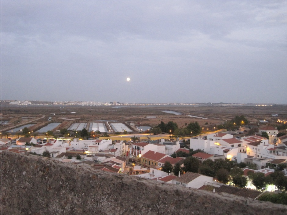 Beyond the wall the moon gently glows over the salt pans