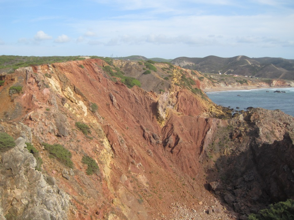 The red cliffs tumbling away