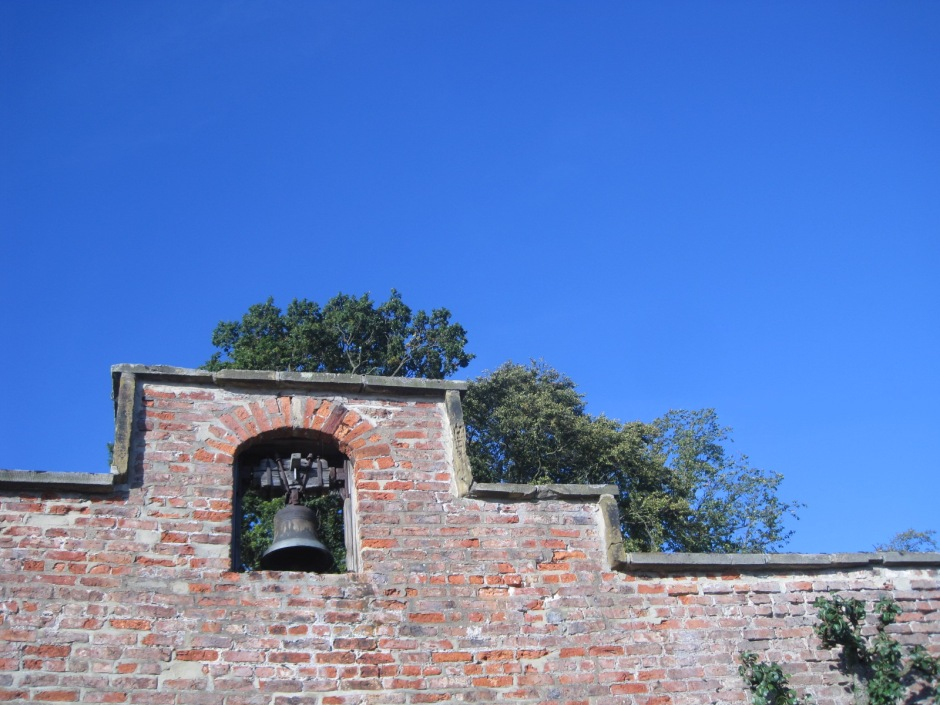 An old bell set high in the wall