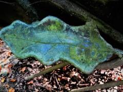 A sculpted leaf adorns a bench