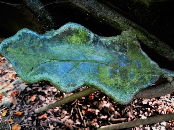 A sculpted leaf adorns a bench