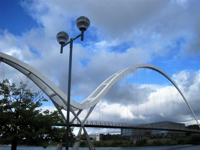 Walk along and cross over the Infinity Bridge